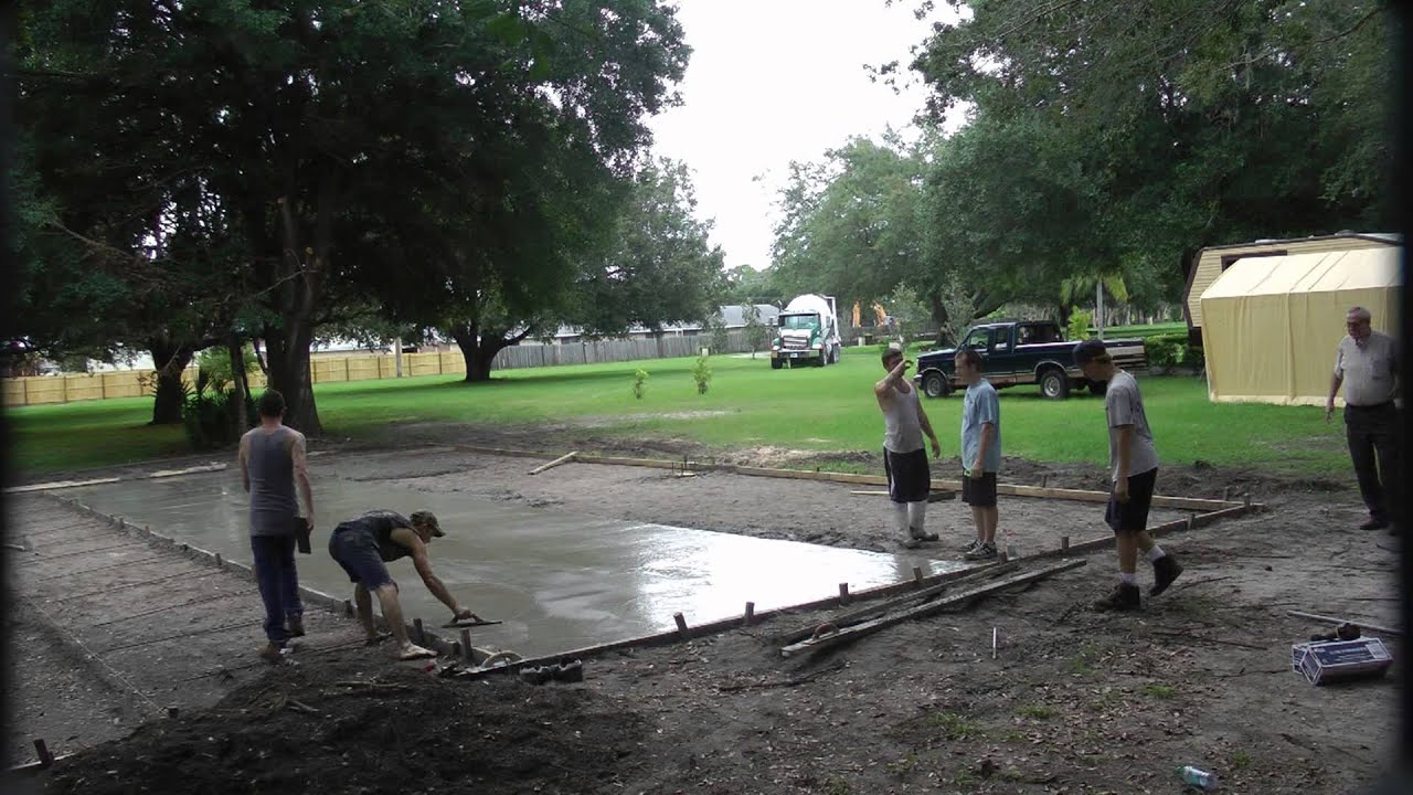 Loving hands 39 basketball court project first concrete for Homemade basketball court