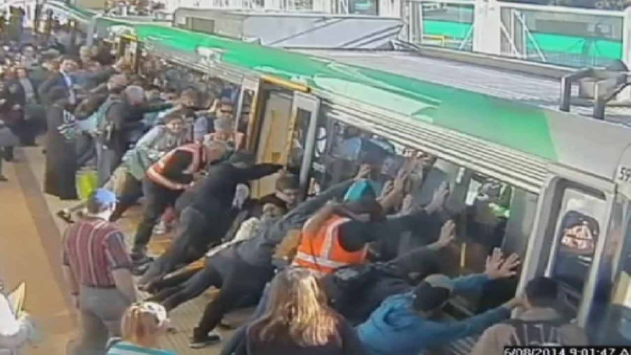Mind The Gap Commuters Push Train To Save Trapped Man In