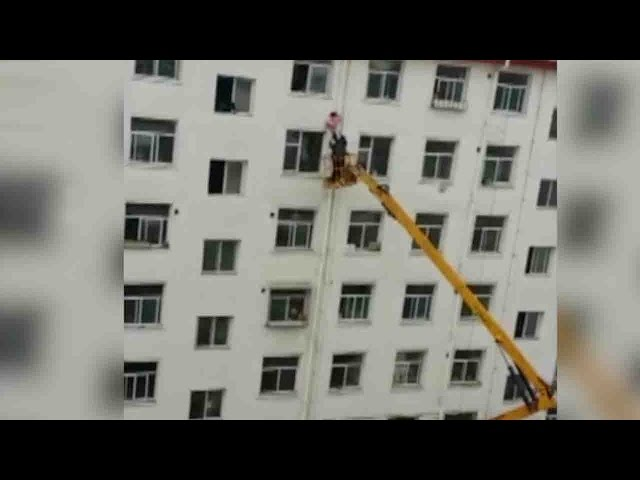 Man saves girl hanging from sixth floor window