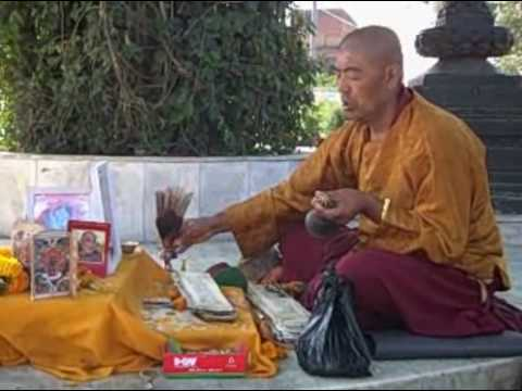 Tibetan Buddhist Monk Chanting at Swayambunath, Nepal