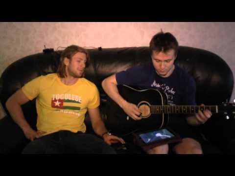 Artur Kulda playing guitar, Jeff Glass sings