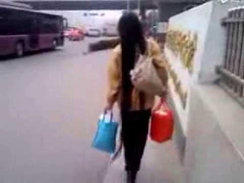 Long Hair Lady Walked On Street In Jinan video