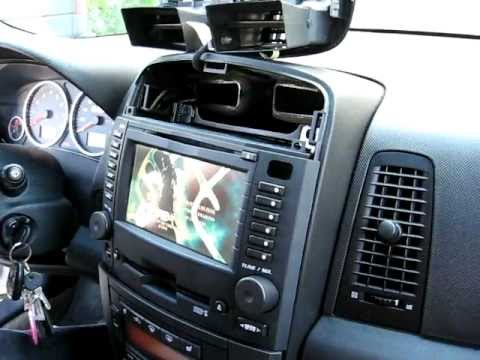 How to Remove Radio / CD Changer /  Navigation from 2004 Cadillac CTS for Repair