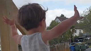 Toddler gets super excited for the garbage truck