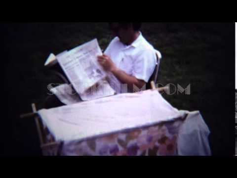 1971: Dad reading newspaper outdoor baby changing table. ZAGREB, CROATIA