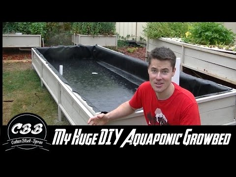 My Huge DIY Aquaponic Grow Bed! Part 2 - Pond liner, Uniseals and more!