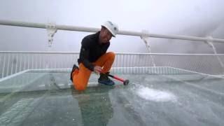 China's giant glass bridge hit with sledgehammer - BBC Click
