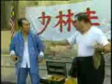 two guys selling med cream in KL, Malaysia speaking chinese dialect.