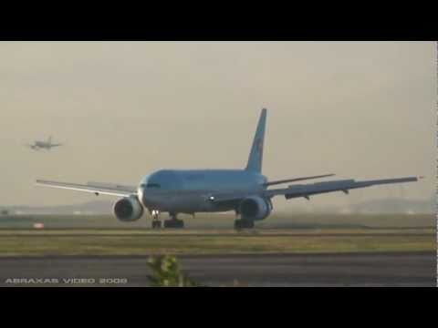 View in HD! Runway 34L early morning arrivals &amp; departures in March. I was spotting here after dropping off my parents at the airport for their flight to Sin...
