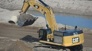 Cat 374D LME loading Cat 735B and John Deere 400D II ADT`s part 1
