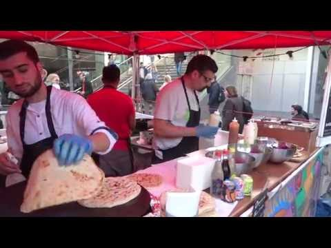 Buying a Pakora Naan Bread Wrap: Indian / Pakistan Street Food at the Alchemy Festival 2016, London.