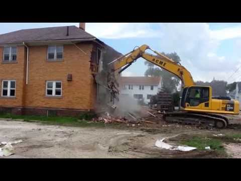 Tearing down brick house demolition