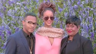 Rihanna, her mother Monica and brother Rajad on their way to the Dior Fashion Show