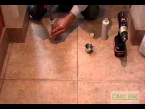 Repair loose floor tile without removing
