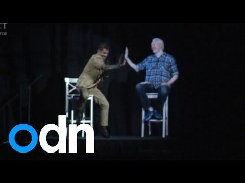 Julian Assange gives virtual high-five as he appears as 3D hologram