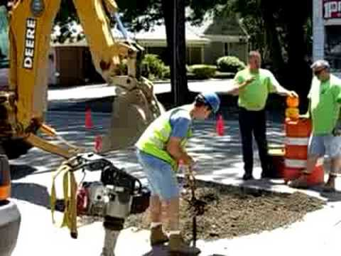 how to fix a sinkhole in a driveway