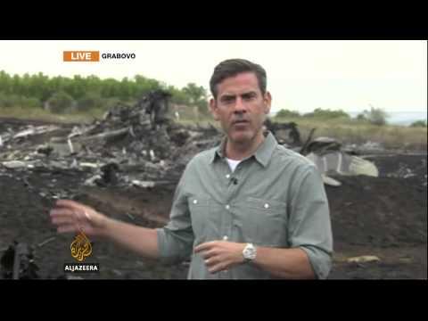 Rescuers comb through debris at Malaysia Airlines crash site