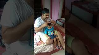 Funny video - Father son head massage...