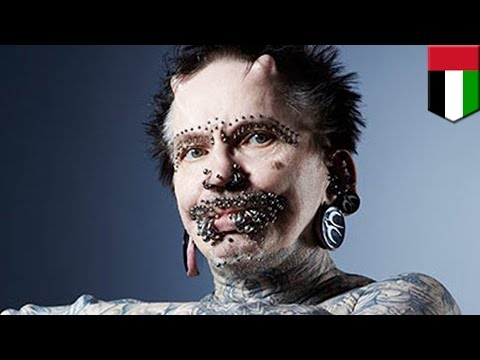 World's most pierced man, Rolf Buchholz, stopped at airport customs in Dubai over black magic fears