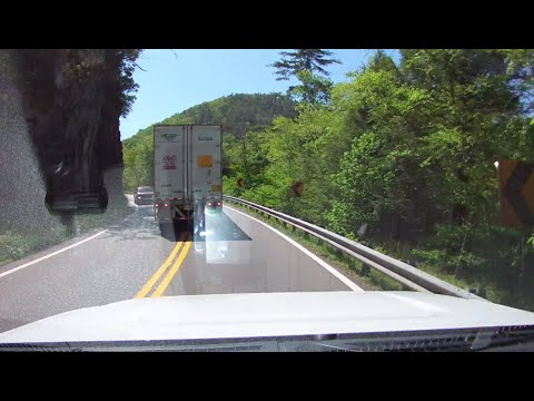 Semi-truck takes up the entire road on corners.