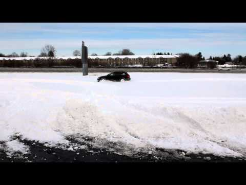 SUBARU OUTBACK PLOWING THROUGH DEEP SNOW - HD