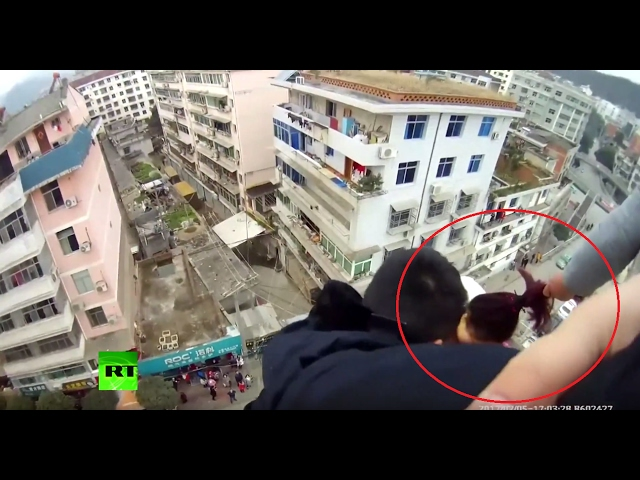 Dramatic GoPro: Man saves suicidal wife from falling to death by grabbing her hair