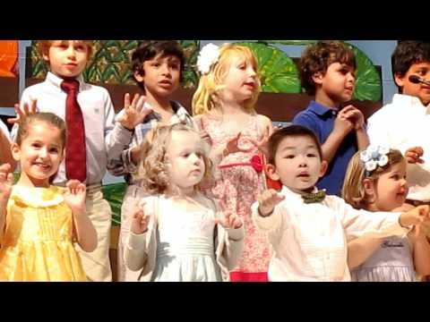 Ashley Beam singing at Hope Montessori