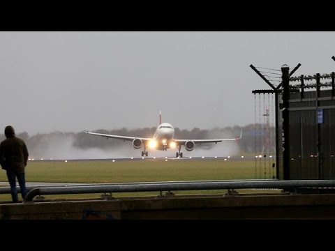 A Swiss A320 made a touch and go around after a rocking approach at Amsterdam Schiphol Airport at 14:19 local time. To use this video in a commercial player or in broadcasts, please email...