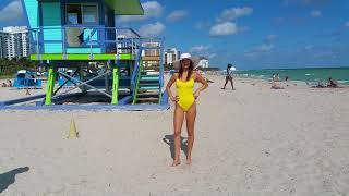 Super model Julia Pereira has fun in the sun wearing a yellow swimsuit at the beach in Miami Beach!