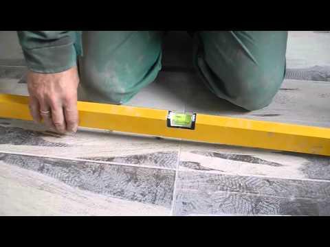 Видео как проверить уровень поверхности