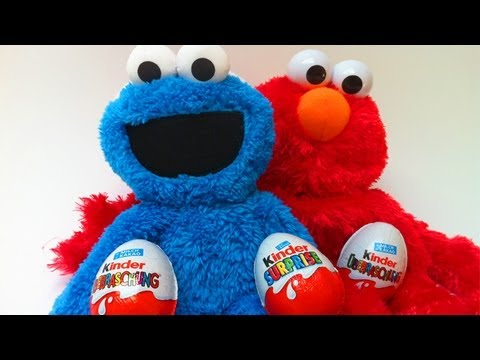 elmo cookie monster unwrapping kinder surprise eggs