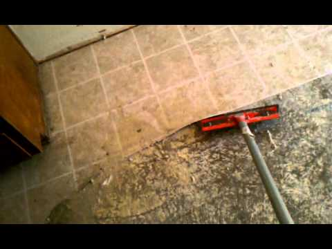 Best way to remove linoleum flooring concrete youtube for Removing concrete floor