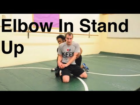 Elbow In Seal Off Stand Up Escape: Basic Bottom Wrestling Moves and Technique For Beginners Image 1