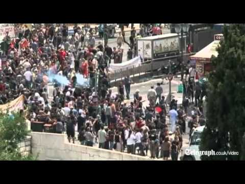 Greek police fire tear gas to disperse Athens protesters