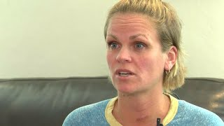 High school coach says bar shooting suspect assaulted her