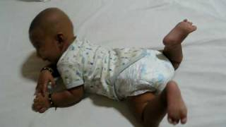 Arnav rolls over for the first time.