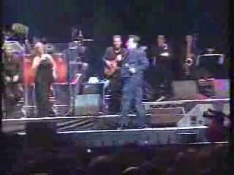 Mexican Singer falls off Stage.flv