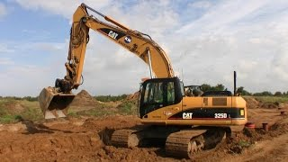 Cat 325D Excavator Rough Grading For A New Road