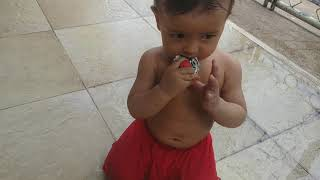 Baby chasing toys car on wet floor