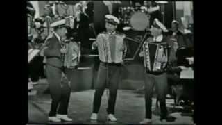 The Three Jacksons:Medley Een cent -- Aan de Amsterdamse grachten -- Ik wil met jou hand in h