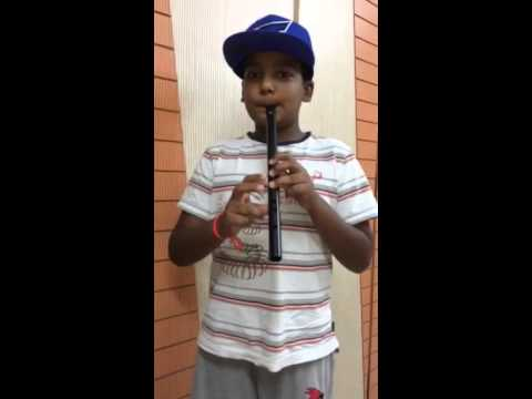 Rushil playing national anthem on his flute