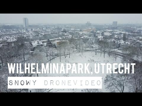4K VIDEO OF DJI MAVIC PRO DRONE FLYING IN A SNOWY PARC