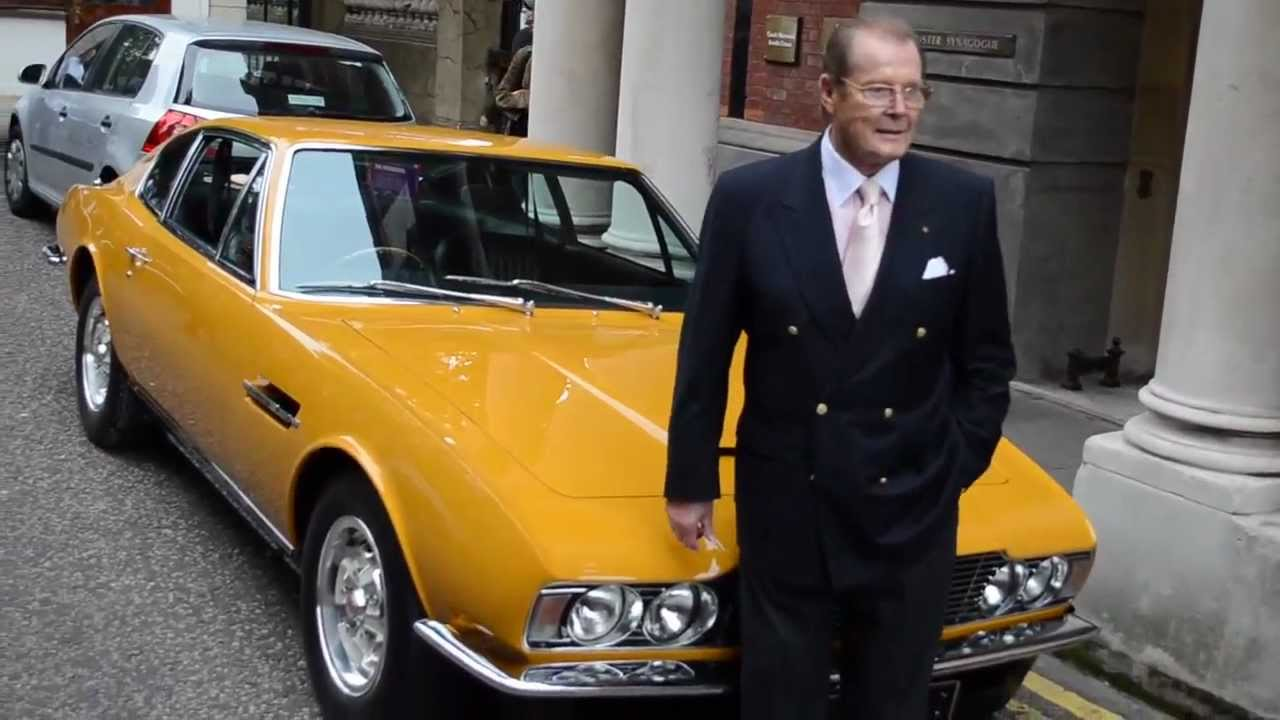 Sir Roger Moore Reunited With His Aston Martin Dbs From