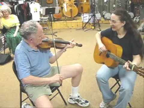 The guitar and fiddle in this video were made in Garland County, Arkansas by W. A. Talley. The guitar was made in 1900 and the fiddle was made 3 days before ...