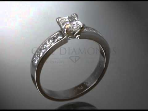 Princess cut,diamond,4 smaller diamonds each side,bold platinum band,engagement ring