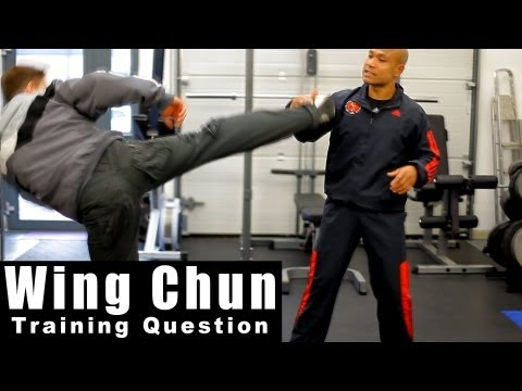 wing chun techniques - How to deal with high round kick.Q11 Image 1