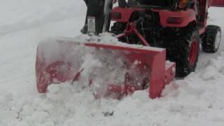 Kubota BX snow blowing close-up's