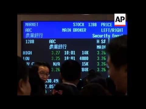China's Agricultural Bank rises in HK debut after tepid Shanghai response