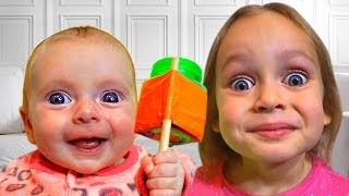 Maya and little baby Mary play with rattles for kids