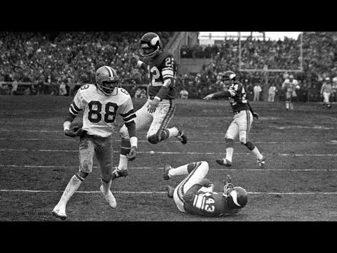 """Cowboys quarterback Roger Staubach threw one of the most famous """"Hail Mary"""" passes ever to receiver Drew Pearson to lead his team to victory over the Minnesota Vikings in the 1975 NFC Divisional."""